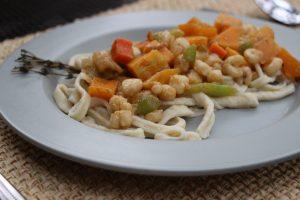 Fresh egg pasta with acorn squash medley
